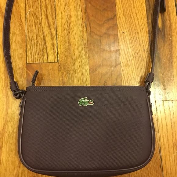 b88b0b370099 Lacoste Handbags - Lacoste cross body purse